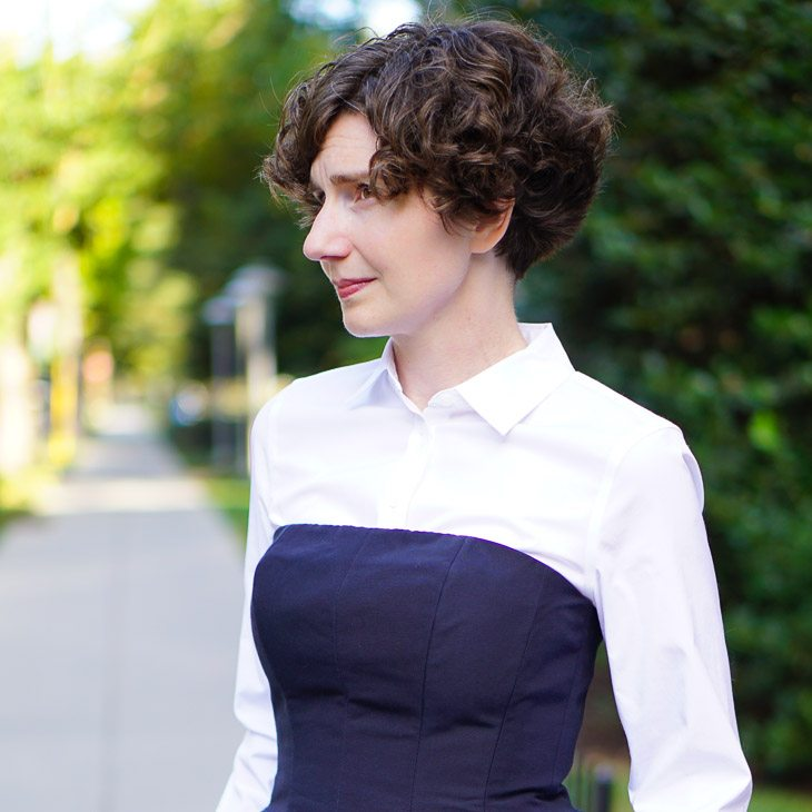 A Navy Suit with a White Blouse